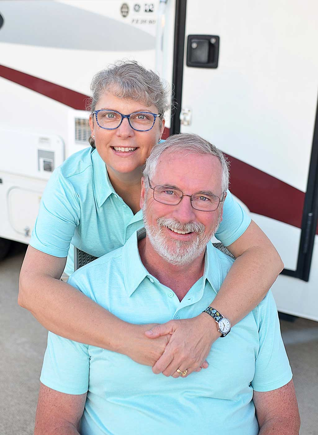 RV Inspectors Brenda and Brian Revard together in front of their recreation vehicle