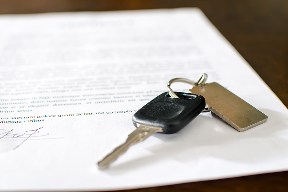 Recreation Vehicle key on top of insurance paperwork after thorough RV inspection services were preformed