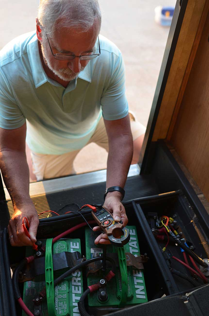 Brian using a polarity tester while preforming an RV inspection