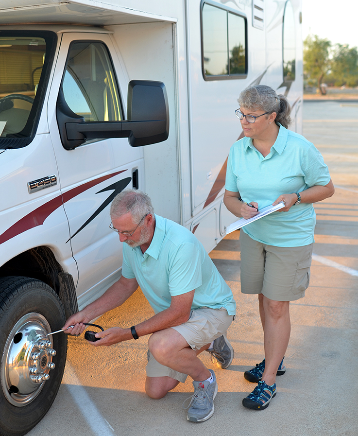 Brian and Brenda preforming RV inspection services